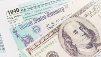 picture of a tax form, government check, and a one-hundred dollar bill