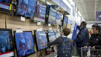 QUINCY, MA - NOVEMBER 23:Shoppers look at televisions at Walmart during the Black Friday sales on November 23, 2012 in Quincy, Massachusetts. Black Friday, the start of the holiday shopping s