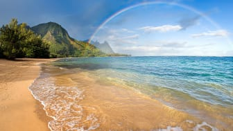 picture of a rainbow over a beach in Hawaii