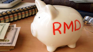Piggy bank with word RMD. Retirement concept.