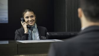 A hotel employee on the telephone.