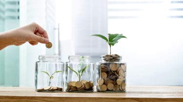 picture of person putting coins in jars with plants growing in them