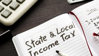 "picture of journal with ""state and local income tax"" written on page"