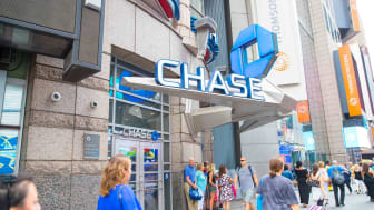 People walk by a Chase bank branch in a city