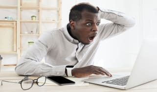 picture of man at computer with shocked look on his face
