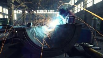 photo of man welding