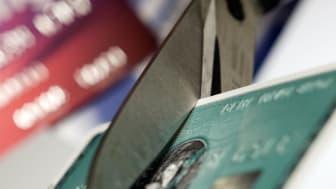 Cutting up a credit card.