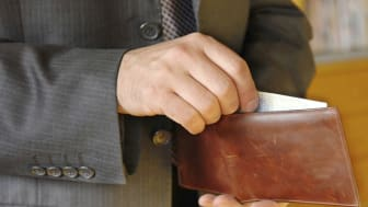 businessman hand holding a opened leather wallet