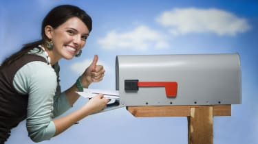 picture of happy woman getting mail from mailbox
