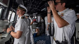 picture of Navy officers and sailors on bridge of a ship