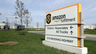 BALTIMORE, MARYLAND - APRIL 14: A sign directs visitors to the 1.2 million-square-foot BWI2 Amazon Fulfillment Center employing about 2500 workers in the Chesapeake Commerce Center April 14,