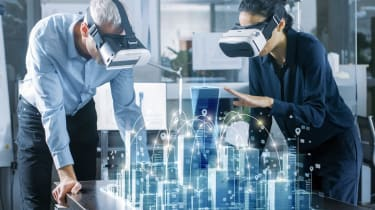 Male and Female Architects WearingAugmented Reality Headsets Work with 3D City Model. High Tech Office Professional People Use Virtual Reality Modeling Software Application.