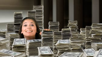 picture of woman surrounded by stacks of money