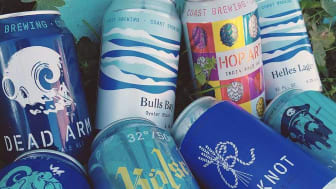 picture of COAST Brewing Company cans of beer
