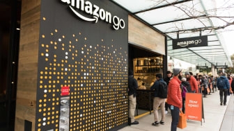People lined up at amazon go cashier less grocery store early in the day in downtown Seattle
