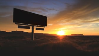 A Billboard in the Arizona desert at sunset.