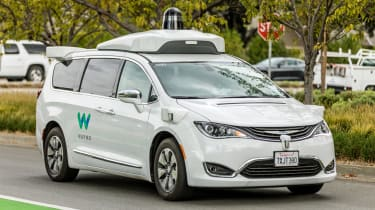 "Mountain View, California, USA - November 3, 2017: .A Waymo, customized Chrysler Pacifica Hybrid, used for Google's autonomous vehicle program near the company""u2019s headquarters in Mountain"