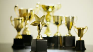 group of trophies on  black table top
