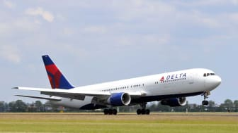 Schiphol, The Netherlands - June 12, 2011: Delta airlines N188DN Boeing 767 plane taking off from Schiphol Airport in The Netherlands on a sunny day.