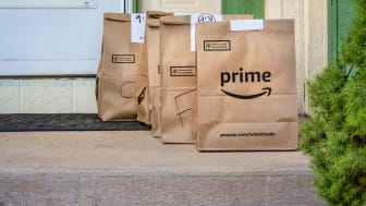 Amazon Pantry bags on front porch of a house