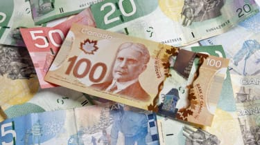 """""""Canadian currency of various denominations with the polymer based 100 dollar bill on top, showing Robert Borden.Similar:"""""""