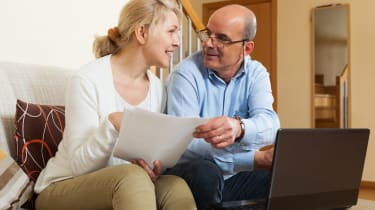 Mature couple with documents and notebook
