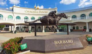 Louisville, Kentucky, USA - August 16, 2015:Churchill Downs in Louisville, Kentucky with a statue of the Kentucky Derby winning horse, Barbaro.