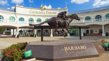 Louisville, Kentucky, USA - August 16, 2015:Churchill Downs in Louisville, Kentucky with a statue of the Kentucky Derby winning horse, Barbaro.