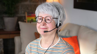photo of woman with headset