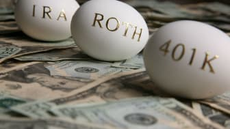 Concept art showing a nest with three eggs that have 401k, Roth and IRA written on them.