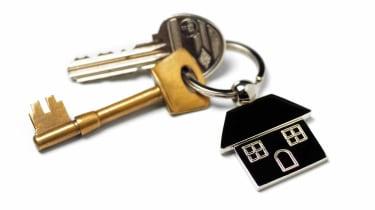 New house, house keys on white
