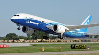 """Oshkosh, WI, USA - July 29, 2011:Brand new Boeing 787 Dreamliner in factory paint scheme taking off during EAA Airventure 2011."""