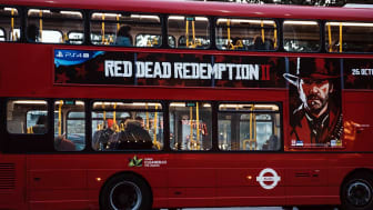 London, UK - November 02, 2018: Red Dead Redemption 2 game advertisement on a red double decker bus in London, UK. The game is a prequel to the original is a hugely popular worldwide.