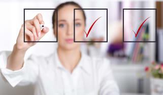 A woman checks off items on a checklist.