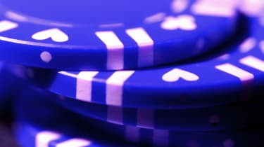 Closeup on a stack of blue poker chips