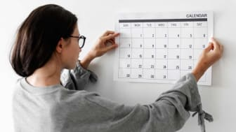 Photo of person with calendar