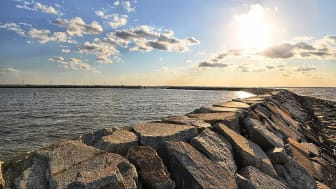 A picture of rocks and a body of water