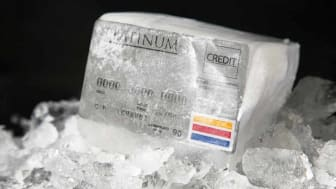 A generic credit card frozen in a block of ice. The Platinum Credit card is available isolated in my portfolio. All names and account numbers are fake.