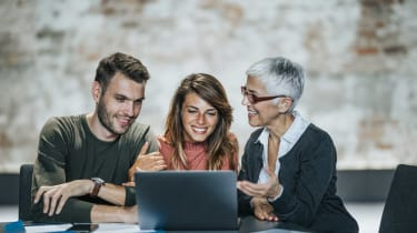 Millennial couple consulting with a senior financial adviser