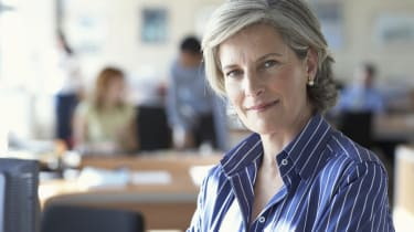 Mature businesswoman in office, portrait, close-up