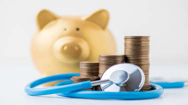 picture of a piggy bank, coins, and a stethoscope