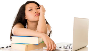 picture of frustrated college student at her computer