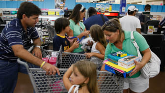 NORTH MIAMI, FL - AUGUST 14:A family prepares their goods to go through the cash register as they as they make purchases at a Wal-Mart Stores August 14, 2008 in North Miami, Florida. The comp