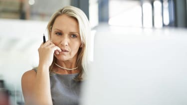 A woman looks at a computer skeptically.