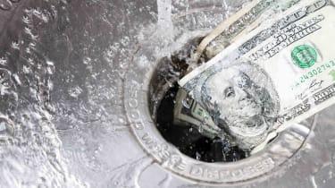 Dollars going down a garbage disposal