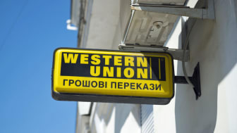Sevastopol, Ukraine - July 28, 2013: A Western Union money transfer sign outside a business in Sevastopol, Crimea, Ukraine.Western Union works with local agents to facilitate transferring mon