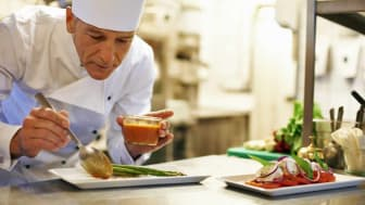 picture of a chef preparing a plate of food