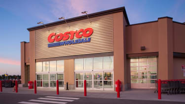 The exterior of a Costco warehouse club at dusk