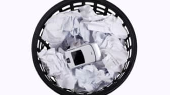 isolated full wastepaper with crumpled papers and mobile phone