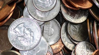 Various assorted american change piling up in jar